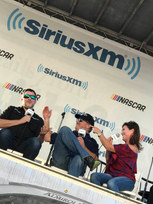 Tony Stewart on-stage with Mike & Angie Skinner at a SiriusXM NASCAR Radio fan event at Daytona International Speedway