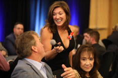 Angie Skinner emceeing the Betty Jane France Poker Tournament benefitting the NASCAR Foundation.
