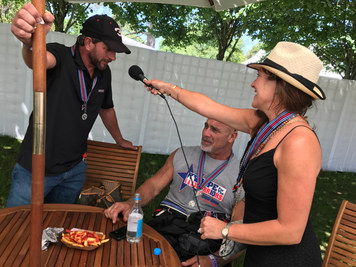 Angie Skinner interviewing Kerry Earnhardt and Bill Goldberg