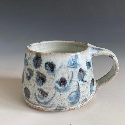 Coffee mug with swirls