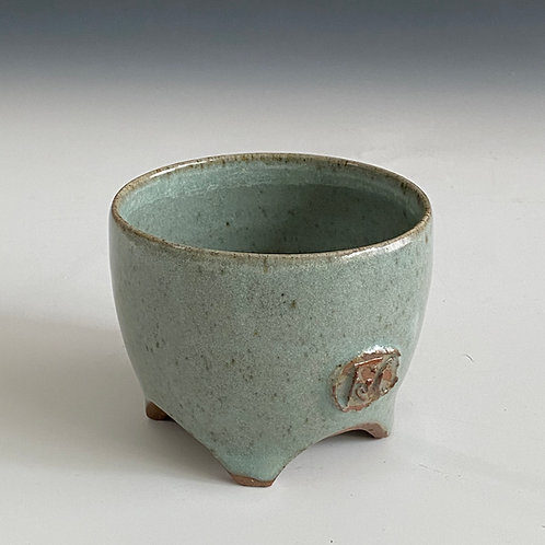 sm green cup with carved feet
