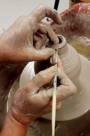 Throwing a bottle on the potters wheel Forest Row School of Ceramics