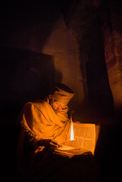 Priest-reading-bible-by-candle-8,-Debre-