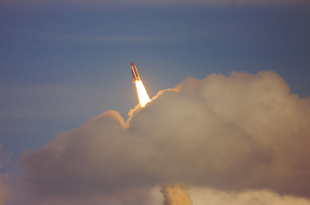 UK space sector rocket launch through cloud, mitigating political risk.