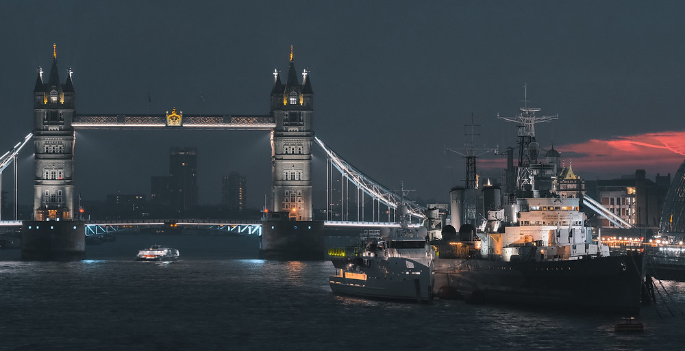 View along the Thames at night in London, UK, where political risk for investment is increasing.