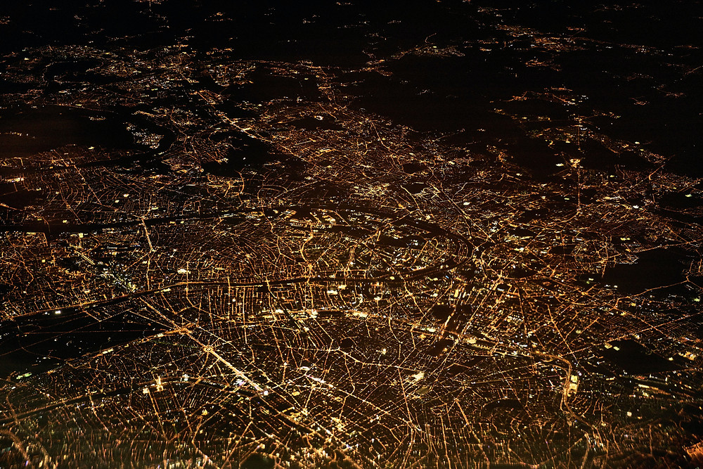 London, UK at night from above. Political risk remains over cross-border data flows.