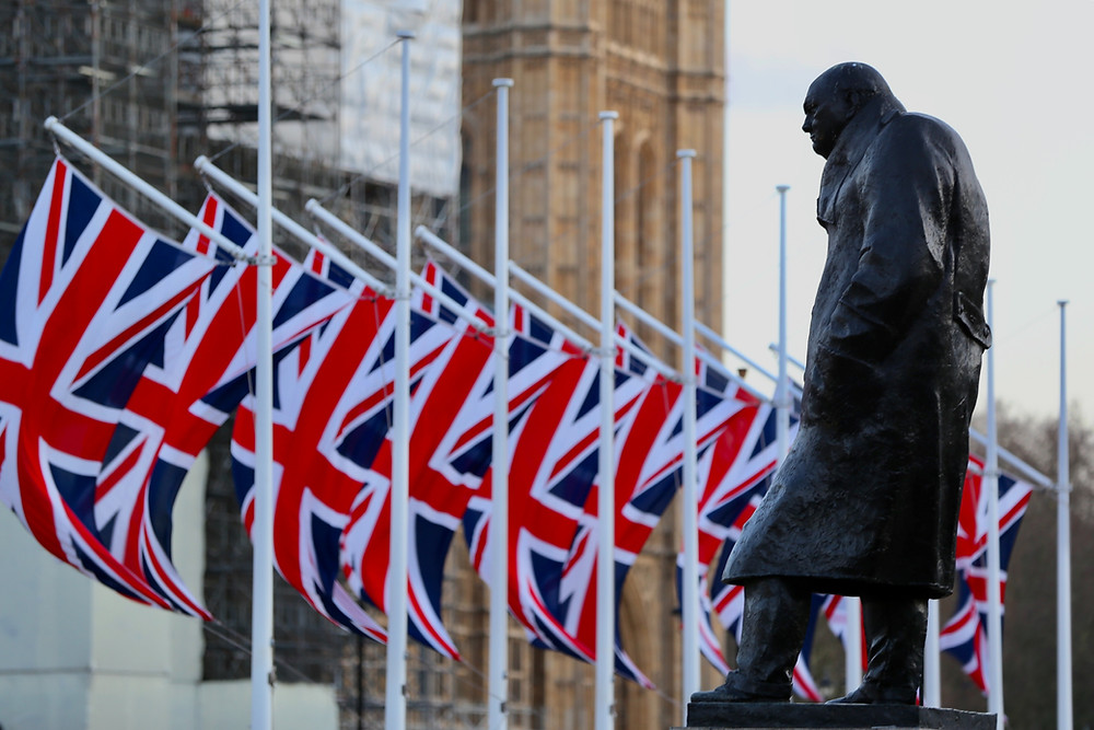 UK flags outside Parliament. There are political risk factors to watch in the UK in 2021.