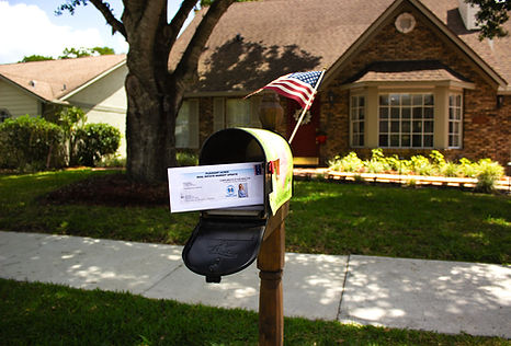 Real Authority real estate market update delivered to a mailbox