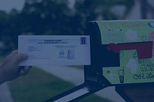 Letter out of Mailbox with Hand.jpg