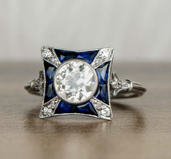 French cut sapphires surrounding old cut
