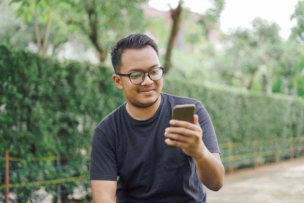 a man lookin at his phone