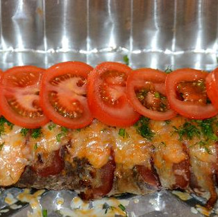 Meatloaf with cheese and tomatoes.