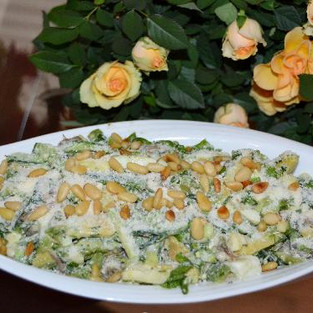Salad with chicken and pine nuts.