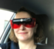 Image of female wearing bioptic with fitover glasses