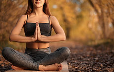 young-woman-practicing-yoga-exercise-autumn-park-with-yellow-leaves-sports-recreation-life