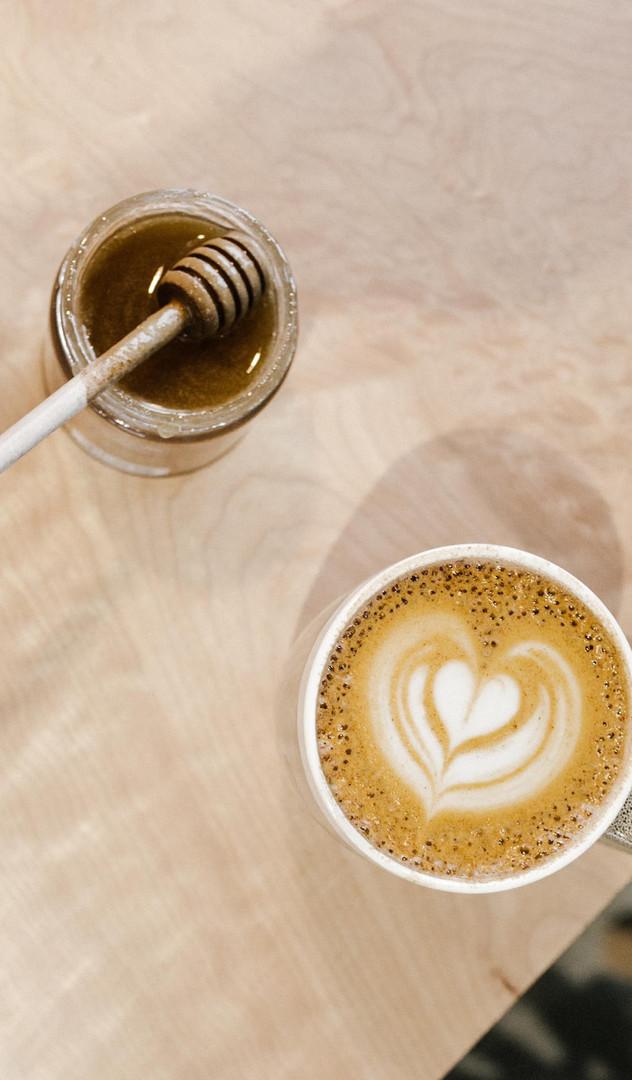 Nossa-Familia-bee-sting-honey-latte-on-w