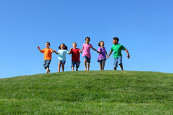 bigstock-Kids-running-on-grass-hill-wit-24830123