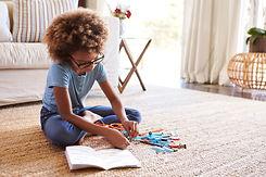 girl-sitting-on-the-floor-reading-instru