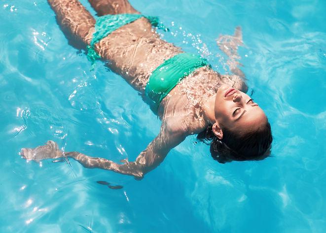exotic-beautiful-woman-sunbathing-and-sw