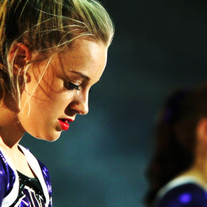 HOW ELITE CHEERLEADERS USE GRIT TO BECOME CHAMPIONS