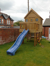 Play tower with slide play house climbing wall