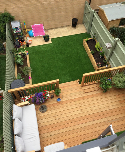 Decking, Artificial Grass And Raised Flower Beds