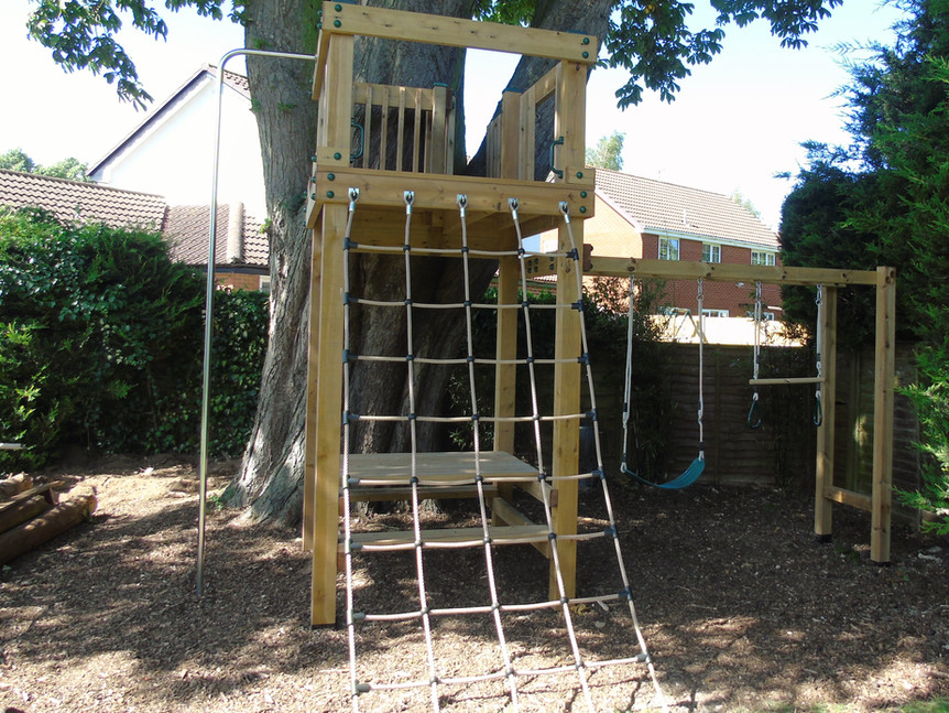Play tower with climbing net, fireman's pole