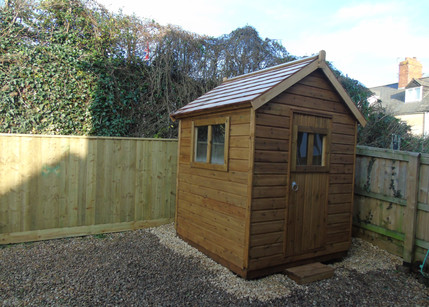 Bespoke Shed with Red Cedar Shingle Roof