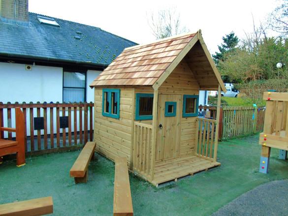 Play house with cedar shingles