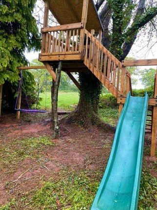 Treehouse with slide and birds nest swing