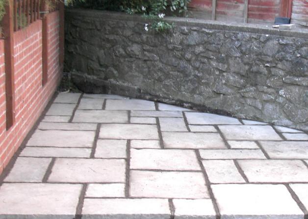 Corner Patio Using Concrete Slabs