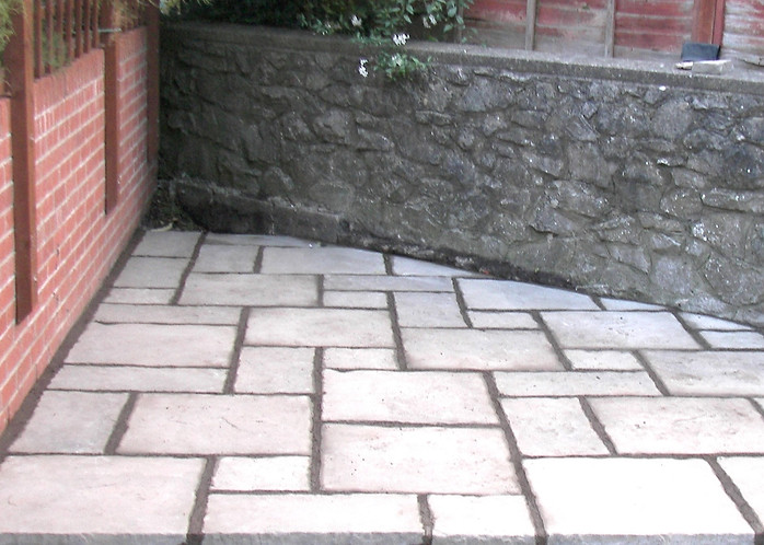 Corner Patio Using Concrete Slabs