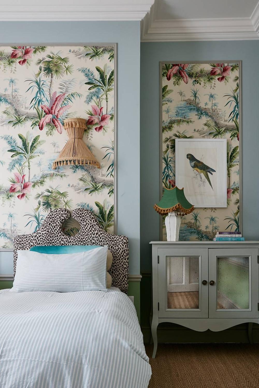 Blue bedroom with panel wallpaper floral design