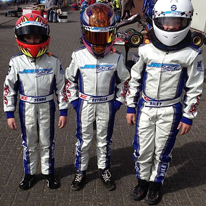 3 young kart drivers in X'zuit racing suits