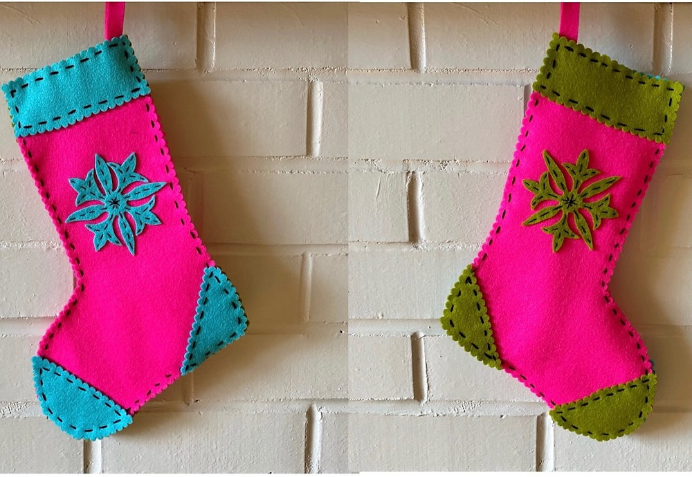 Hand cut wool felt stocking with running stitch embroidered embellishments.