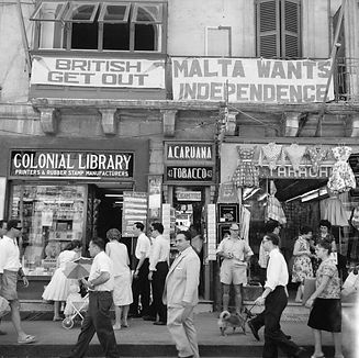 A_view_of_shops_with_anti-British_and_pro-Independence_signs,_possibly_on_Kings_Street,_Va