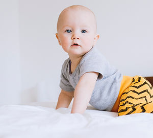 baby on bed