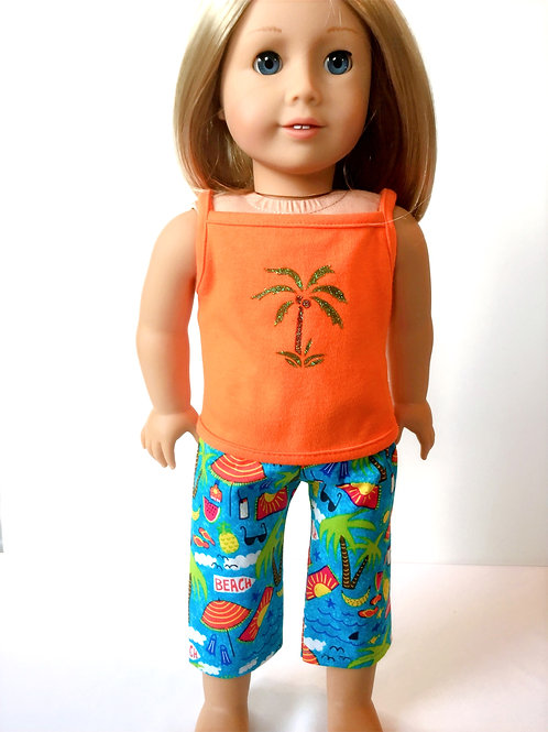 Tropical print cropped pants and orange tank top