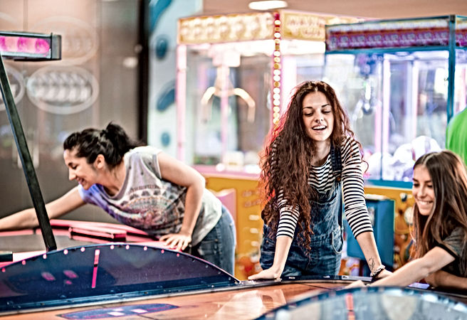 Girls Playing at Arcade