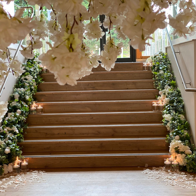 Stair garlands, mill barns wedding, blossom tree hire