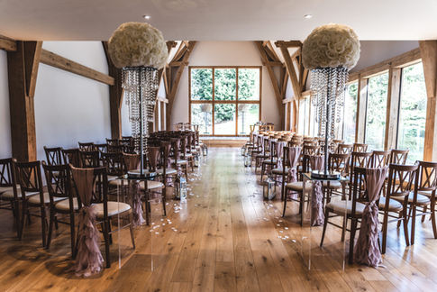 floral centrepieces, aisle stylying, midlands venue stylists, perfectly unique occasions, mill barns wedding, wedding decor