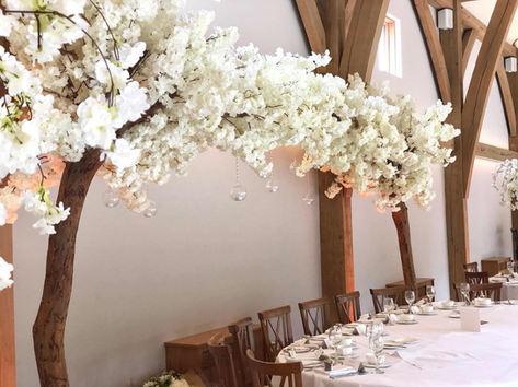 ivory canopy trees, wedding arch, wedding backdrop, blossom tree hire, blossom tree backdrop, blossom tree wedding hire, venue decorations