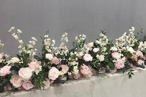 Lavish top table arrangement
