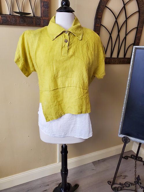 yellow polo with a white under tank