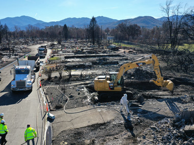 Wildfire cleanup crews begin ash and debris removal at Bear Lake Estates Mobile Home Park
