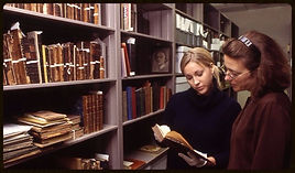 women looking at records in an archive