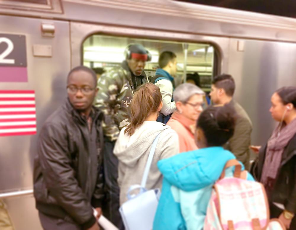 People Getting On Subway Train