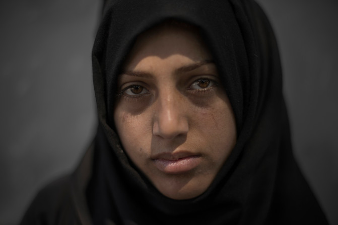 """Yasmine, 16, is one of thousands of children who has been forced to live on the streets of Istanbul, Turkey, April 27, 2016, after fleeing the war in Syria.  """"It's horrible, I feel shy, but I'd rather sit here and beg than get married like my friends""""."""