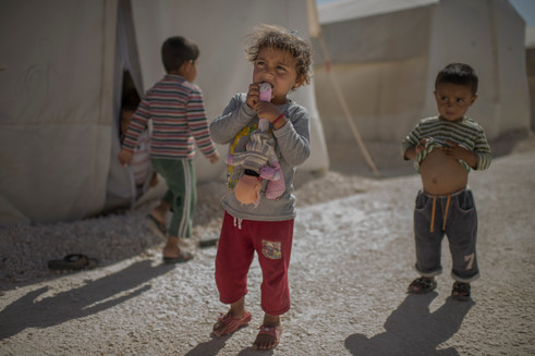 """Alina, 3, from Aleppo is walking around with her doll in Suruc refugee camp, Turkey, April 25, 2016. It's the largest refugee camp in Turkey, approximately 15 000 children lives here according to Unicef.  """"I bought the doll when she was a baby. The doll has no name but she always play with it. It's the only toy we got with us from Syria"""", says Alinas mother Gulistan."""