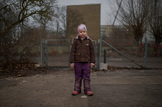 """Nestled inbetween the area's high-rise buildings and a green park that looks like the countryside is Almgårdens preschool. In the backyard Jasmine is by her self.  """"My mom is always sick because my dad does not help out at home. We would go to the movies tonight but now we can´t because she is sick. Dad is stupid. He is just watching horror movies and adult films. And he is mean to our dogs. He says he will tape their penis."""""""